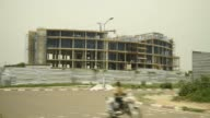 Laborers work on the upper floor of the Cit des Affaires de N'Djamena construction site in N'Djamena Chad on Wednesday Aug 16 2017