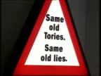 Labour advertising campaign at home and abroad LA John Prescott onto platform with backdrop 'Same Old Tories Same Old Lies' CMS Slogan MS John...