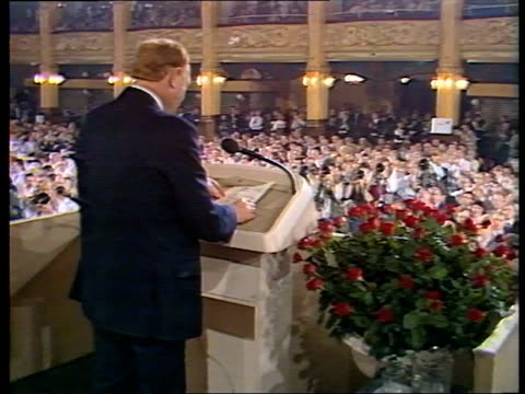 Labour Black Section row ITN LIB Labour Conf 1988 as Neil Kinnock up to dais for speech Vauxhall huge banner over doorway as protestors stand