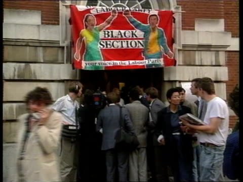 Labour Black Section row ITN LIB Vauxhall huge banner over doorway as protestors stand