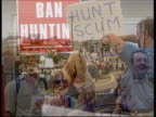 Day 3/Hunt protests ITN ENGLAND Bournemouth Prohunting demonstrators towards waving placards during protest march PULL OUT MS Placard carried along...