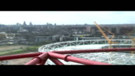 London Olympic Park EXT View of Olympic Stadium and London skyline from ArcelorMittal Orbit observation tower PAN ArcelorMittal Orbit observation...