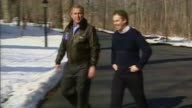Jeremy Corbyn's foreign policy LIB USA Maryland Camp David EXT Tony Blair and George W Bush along road and Blair waving to press