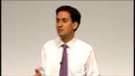 Ed Miliband takes part in QA session Twitter questions appearing on screen and Eddie Izzard looking up at them Ed Miliband reading Twitter questions...