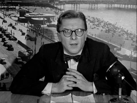 day one ENGLAND East Sussex Brighton INT Reporter to camera SOF / Harold Wilson MP speech SOF Mr Macmillan our great bookmaker turned pawnbroker...