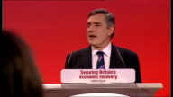 Gordon Brown keynote speech **FLASHLIGHT ENGLAND Sussex Brighton INT Gordon Brown through applauding audience onto stage as shaking hands with...