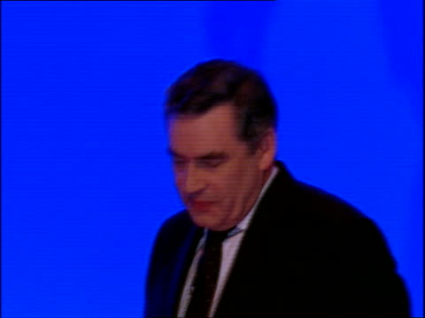Gordon Brown's keynote speech **BEWARE Brown along then shaking hand of Harriet Harman MP then mounting rostrum and thanking supporters as audience...