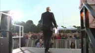 Jeremy Corbyn attacks the Conservatives on eve of conference ENGLAND East Sussex Brighton EXT Various shots of crowd of people chanting 'Jeremy...
