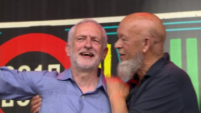 Jeremy Corbyn chant popularity R240617001 / ENGLAND Somerset Glastonbury music festival EXT Michael Eavis and Jeremy Corbyn MP on stage as crowd...