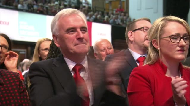 Jeremy Corbyn keynote speech INT Labour Party delegates singing and clapping along to 'Oh Jeremy Corbyn' chant SOT Jeremy Corbyn scarf waved in crowd...