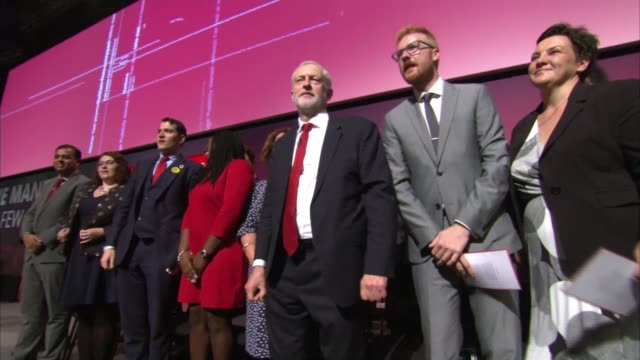 Jeremy Corbyn speech cutaways Wide shots of Jeremy Corbyn MP giving speech SOT / Corbyn and others singing Red Flag and other songs on stage SOT /...