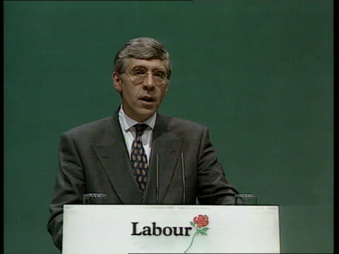 Labour Party Conference landmines ENGLAND Sussex Brighton Jack Straw MP standing behind podium as two women from a rough council estate talk about...