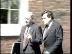 Handling of the economy ITN USA Washington Gordon Brown MP along chatting man PAN as BV away into headquarters of International Monetary Fund