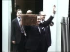 Handling of the economy LIB Downing Street Healy standing on doorstep of Number 11 with battered budget briefcase in hand Sussex Brighton Centre GV...