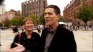 David Miliband arrival ENGLAND Manchester Manchester Central EXT David Miliband MP along with his wife Louise Shackleton towards waiting press David...
