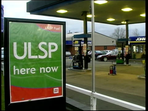 Labour promise tax cut on unleaded petrol ITN London Petrol station forecourt 'ULSP' sign outside garage CSs 'Ulta low sulphur petrol' sign on pump...
