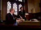 Labour Smear Campaign LA Neil Kinnock sitting at desk as secretary gives him papers TX