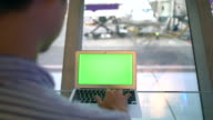 Labtop Greenscreen at terminal Airport