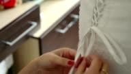 Lacing up a Bridal Corset