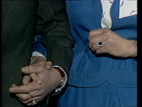 Lady Diana Spencer shows off engagement ring as Prince Charles talks of informing Queen Elizabeth II of his wish to marry London 24 Feb 81
