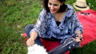 Lady Feeding Maltese Dog