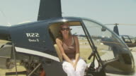 Lady in Robinson R22 Helicopter, talking, Australia