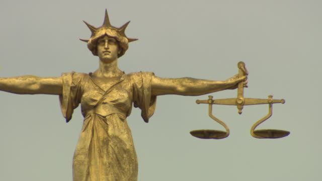 Lady Justice statue, big close up, on top of Old Bailey, London