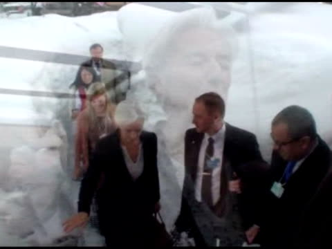 MS Lagarde in elevator / walking down hallway / arriving at Bloomberg TV studios/various angles of interview / MS TV screen showing Bloomberg...