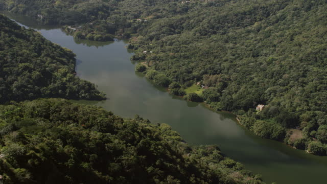 WS AERIAL POV Lago Dos Bocas lake and Rio Caonillas waters meet at bottom of green canyon / Arecibo, Puerto Rico, United States