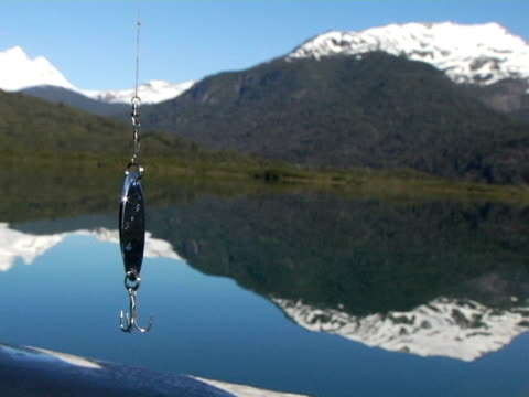 SELECTIVE FOCUS, Lago Mascardi and snow capped mountains, fishing hook on foreground, Nahuel Huapi National Park, Argentina
