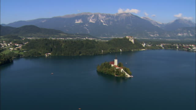 AERIAL Lake Bled with Pilgrimage Church of the Assumption of Mary on small island / Slovenia