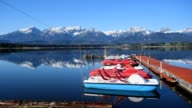 Lake hope with rowing and pedal boat in spring, Hopfen am See, Allgau, Bavaria, Germany