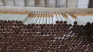 Lambert and Butler cigarettes manufactured by Imperial Tobacco Group Plc sit stacked ahead of packaging at the company's factory in Nottingham...