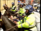 Lancashire Oldham EXT LMS Police officers in riot gear Mounted police officers next protestors Police officers shepherding AntiNazo League protestors...