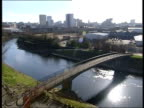 Lancashire Salford EXT TGV Bridge across River Irwell PAN Vox pops woman machinist SOT