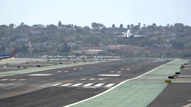 Landing airplane in California airport 4K