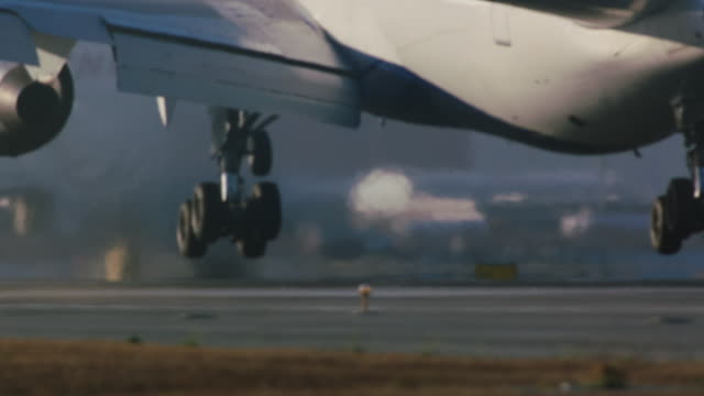 Landing gear touches down on runway as Delta Airlines jumbo jet arrives