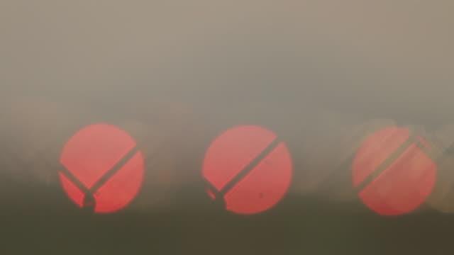 Landing lights on runaway air strip while sunrise at the Phuket airport, Thailand