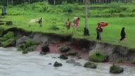 Landless People running to ride launch in Coastal area in Bangladesh on August 14 2017 Bangladesh a country which is ranked as one of the world's...