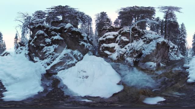 360VR landscape 8K video cascades of mountain river in winter
