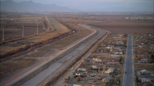 LOW AERIAL Landscape at US-Mexican border at El Paso, Texas, USA