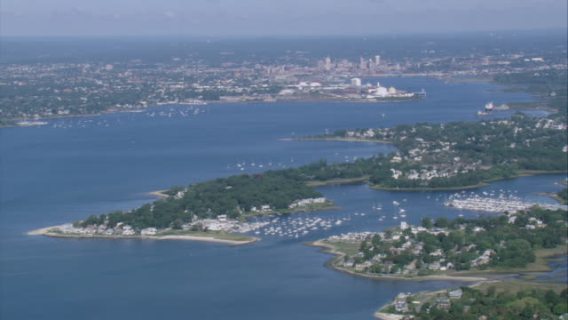AERIAL Landscape of communities, marinas and boats along the Providence River with Bollock Neck, Bollock Cove and Bay Spring in the foreground / Barrington, Rhode Island, United States
