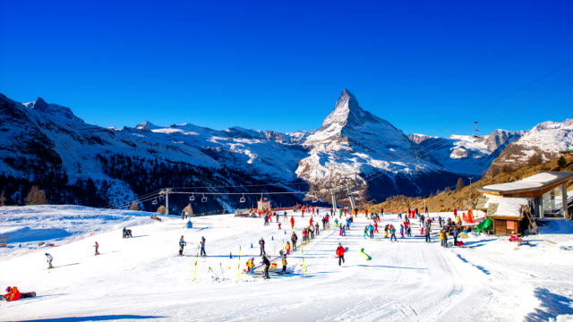 Landscape of Matterhorn (a mountain of the Alps) with tourists