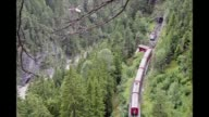 A landslide derailed a passenger train in the Swiss mountains on Wednesday sending one carriage plunging into a ravine but it appeared that...