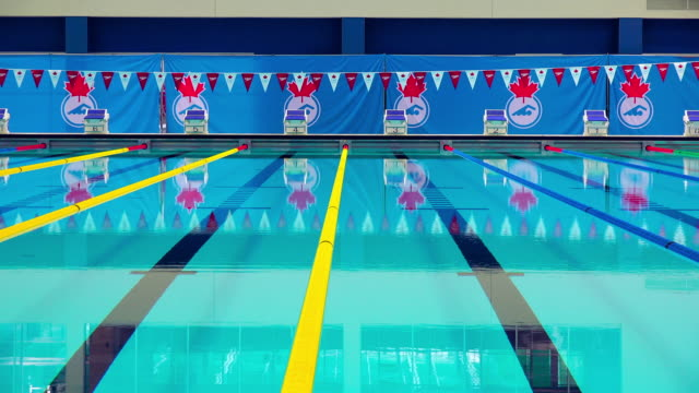 Lanes and reflection of Canadian symbols on the clear transparent water of the new sports venue The Toronto Pan Am Sports Centre is the most...