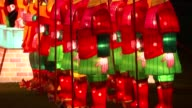 Lantern Festival starts in Chiswick for Chinese New Year ENGLAND London Chiswick Park Illuminated dragon lantern TILT UP Chinese soldier lanterns lit...