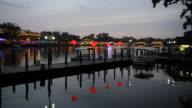 Lanterns illuminate a dock at Lake Houhai late in the day.