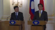 Laos Prime Minister Thongloun Sisoulith meets his Japanese counterpart Shinzo Abe in Tokyo during a five day official visit
