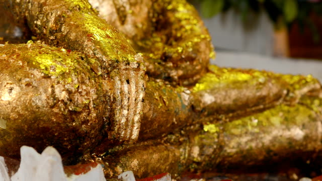 lap image of Buddha is decorated with gold leaf