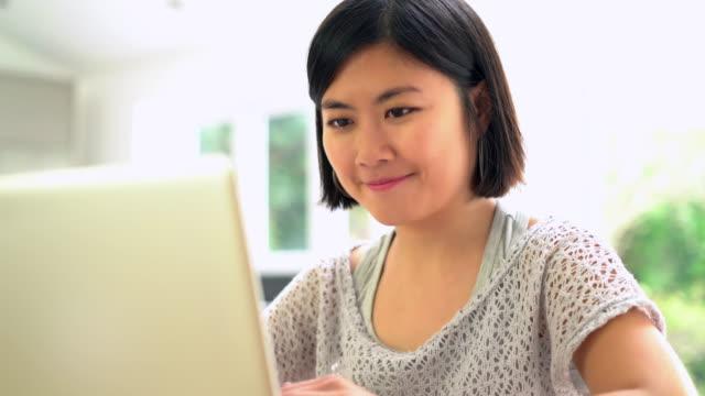 Laptop Asian woman typing.